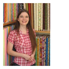 Sarah with some of our quilt shops fabrics!